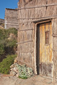 The doors of the old fisherman's house on the beach. Portugal, Sagres. — Stock Photo