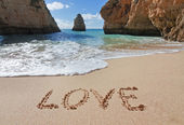 Word love in the sand at the beach on Valentine — Stock Photo