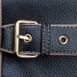 Royalty-Free Stock Photo: Belt buckles and textured black leather.