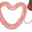 Rich red beads in the shape of a heart. On a white background. — Stock Photo