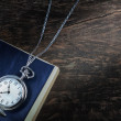Stock Photo: Pocket watch on old book, notebook.
