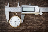 Pocket watches are measuring sliding caliper. — Stock Photo