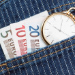 Pocket watch in your pants and jeans with money euro. Closeup. — Stock Photo