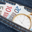 Pocket watch with chain in jeans and money euro. Close-up. — Stock Photo
