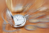 Pocket watch against the background of the euro coins, in focus. — Stock Photo