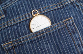 Pocket watch in a jeans pants. Closeup. — Stock Photo