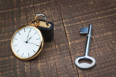 Padlock store time and the key controls. The concept time manage — Stock Photo