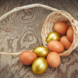 Easter eggs in an inverted basket. Group of golden eggs. — Stok fotoğraf