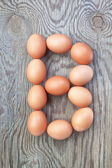 A letter b from the eggs for easter. On a wooden texture. — Stock Photo