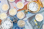 Pocket watches and euro money. — Stock Photo
