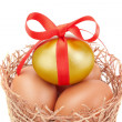 Nest and the band Easter golden eggs. On a white background. — Stock Photo