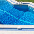 Clear blue pool in the park. Closeup. - Stock Photo