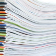 A large stack of colorful magazines. Close-up. — Stock Photo