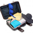 Stock Photo: Brassiere and Panamon suitcase for holiday. On white bac