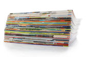 A large stack of magazines. On a white background with shadow. — Stock Photo