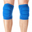 Knee pads to protect the games on male legs. On a white backgrou — Stock Photo