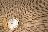 Antique pocket watch on a textured woven straw. Close-up. — Stockfoto