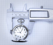 Concept image of a pocket watch and trammel. — Stock Photo
