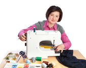 Middle-aged woman working at a garment factory. On a white backg — Stock Photo