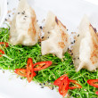 Foto Stock: Dumplings filled with sushi products up close. With black vinega