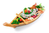 Collection of species sushi on the decorative plate ship. On a w — Stock Photo
