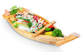 Abundance of sushi east dishes from fresh ingredients on the pla — Stock Photo