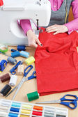 Woman sews on the sewing machine parts wear. — Stock Photo