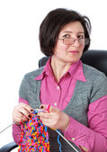 Middle-aged woman knit in my spare time. — Stock Photo