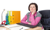 Middle-aged woman secretary at the desk. — Stock Photo