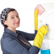 Stock Photo: Middle-aged housekeeper cleans interior. Close-up.