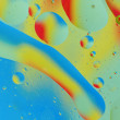 Stock Photo: Decorative circles form of oil on a colorful background. abstrac