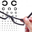 Foto de Stock  : Glasses in hand of mon background of table Golo