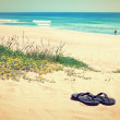 Slippers on the background of the beautiful beach and the sea. I — 图库照片