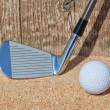 Stock Photo: Golf stick and ball support wooden close-up on sand.