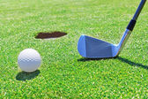 Golf stick ball near the hole. Against the background of grass. — Stock Photo