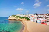 Portuguese villa in Carvoeiro beach with clear blue sea. In the — Stock Photo