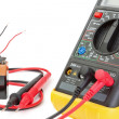 Electrical multimeter to check the resistance. On a white backgr — Stock Photo