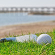 Foto de Stock  : Golf stick and ball on grass with background of nature. Close-