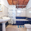 Vintage retro bathroom. Blue tiles. — Stock Photo