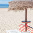 Wooden beach umbrella and sun bed on the beach. For the holidays — Stock Photo