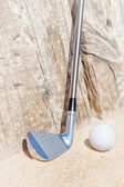Golf stick and ball on the sand. Close-up. — Stock Photo
