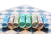 Paper money in the form of the euro on the chessboard. Concept I — Stock Photo