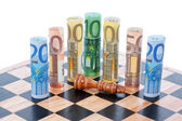 Money euro on chess board and Defeated figure of the king. — Stock Photo