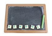 Blackboard and chalk for the written word school. — Stock Photo