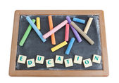 School board to chalk colored chalk and written word education. — Stock Photo