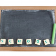 Blackboard and chalk for the written word school. — Stock Photo