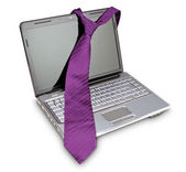 Elegant necktie on a laptop computer as a symbol of fashion. On — Stock Photo