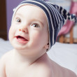 Cute baby in a hat laughing. Close-up portrait. — Foto de Stock