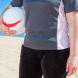 Stock Photo: Middle-aged womplaying volleyball at beach. Summer.