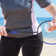 Stock Photo: Girl plays badminton on beach. Close-up.